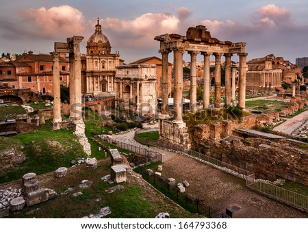 Roman Forum (Foro Romano) and Ruins of Septimius Severus Arch and Saturn Temple at Sunset, Rome, Italy