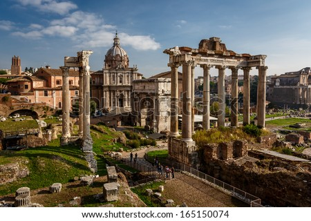 Roman Forum (Foro Romano) and Ruins of Septimius Severus Arch and Saturn Temple in Rome, Italy - stock photo