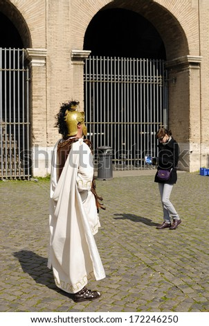 ROMAN FORUM, ROME- MARCH 14: A street performer dressed as a centurion performs for tourists, March 14, 2010 in Rome, Italy. - stock photo