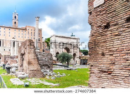 Roman Forum s a rectangular forum (plaza) surrounded by the ruins of several important ancient government buildings at the center of the city of Rome.  - stock photo