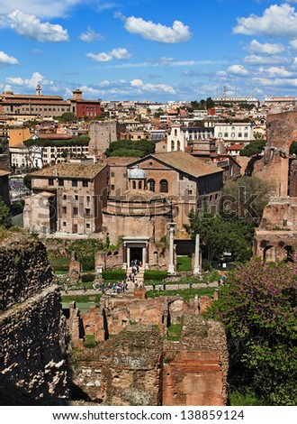 Roman forum, view of the Temple of Romulus (The basilica of Santi Cosma e Damiano) from the Palatine Hill, Rome, Italy - stock photo