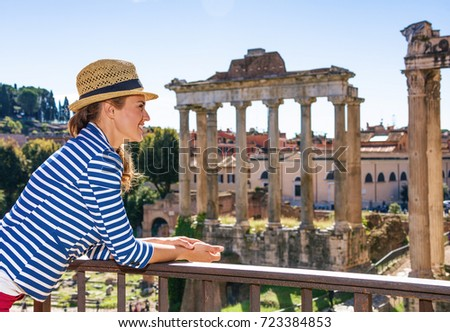 Roman Holiday. happy elegant tourist woman near Roman Forum in Rome, Italy exploring attractions