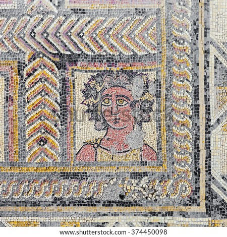 Roman mosaic portraying the Autumn Season or Fall character, in the House of the Fountains. Conimbriga in Portugal, is one of the best preserved Roman cities on the west of the empire. - stock photo