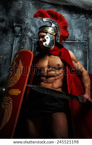 Roman muscular shaped warrioir with sword and shield in his hands - stock photo