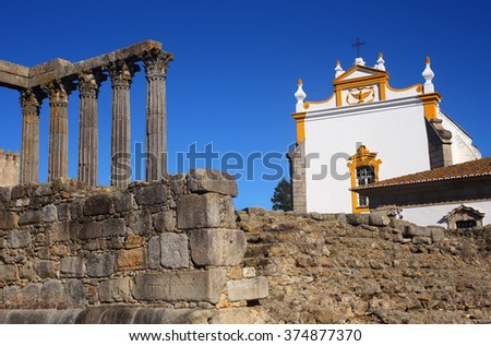 Roman ruins of Diana's Temple and the chapel of Saint John the Evangelist. Evora, Alentejo region, Portugal. UNESCO World Heritage Site. (framed for double page layout) - stock photo