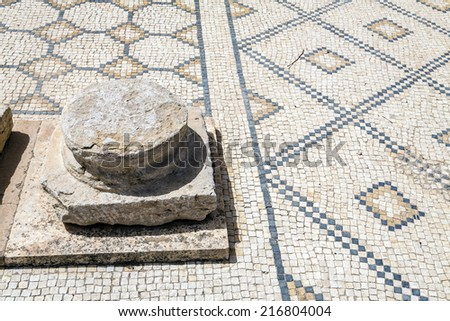 Roman ruins of Sufetula near Sbeitla, Tunisia. Detail of ceramic remains of the flooring - stock photo