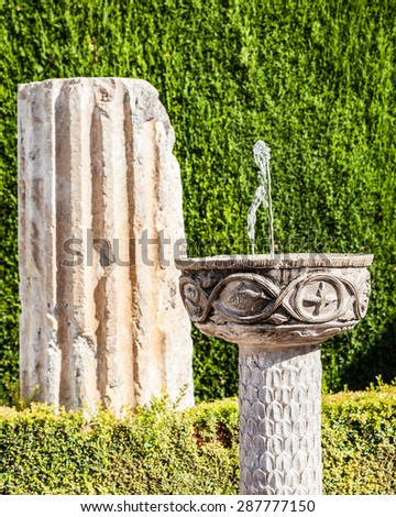 Roman ruins used as garden furniture in Italy - stock photo