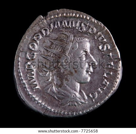 Roman Silver Coin - Gordian On A Black Background - stock photo