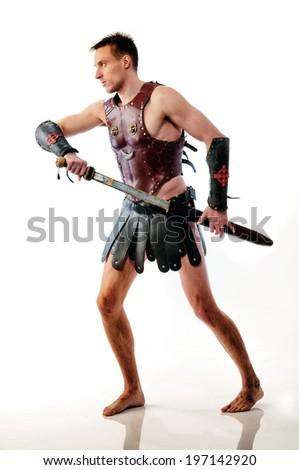Roman soldier on white background prepare to battle - stock photo