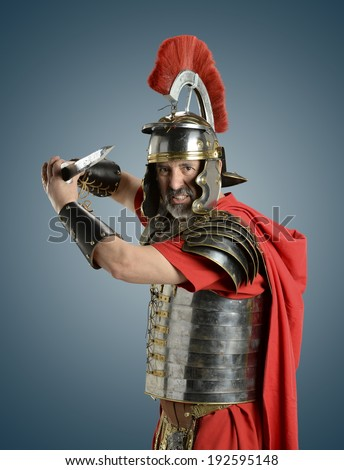Roman Soldier with sword ready for war isolated on a blue background