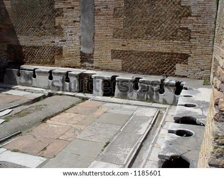 Roman toilets, Ostia Antica - stock photo