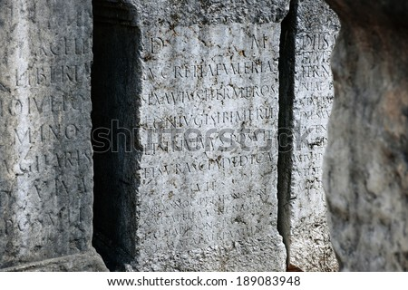 Roman tomb plates with latin inscription in ancient cemetery - stock photo