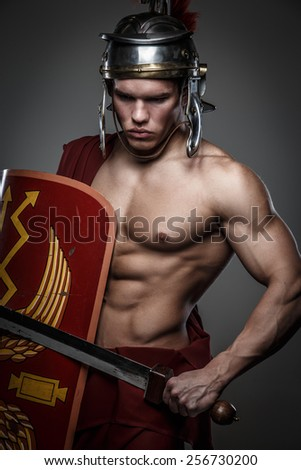 Roman warrior with sword and shield isolated on grey.