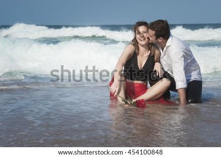 Romance Engagement Couple Love Beach Ocean Lovers Relationship - stock photo
