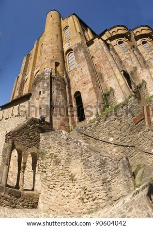 Romanesque tower and walls  of the Abbey Church of St. Foy, Conques, France