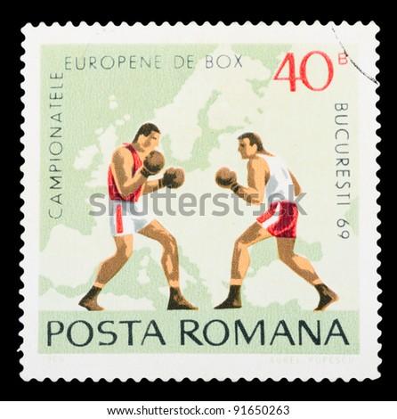 ROMANIA - CIRCA 1969: a stamp printed by ROMANIA shows boxing, series, circa 1969 - stock photo