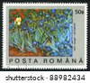 ROMANIA - CIRCA 1990: A stamp printed by Romania, shows Field of Irises by Vincent Van Gogh, circa 1990 - stock photo