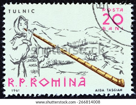 """ROMANIA - CIRCA 1961: A stamp printed in Romania from the """"Musicians """" issue shows Alpenhorn player, circa 1961.  - stock photo"""