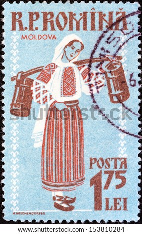 "ROMANIA - CIRCA 1958: A stamp printed in Romania from the ""Provincial costumes"" issue shows woman from Moldavia, circa 1958.  - stock photo"