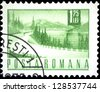 """ROMANIA - CIRCA 1967: A stamp printed in Romania shows a Lakeside highway, without inscription, from the series """"Postal and transport"""", circa 1967 - stock photo"""