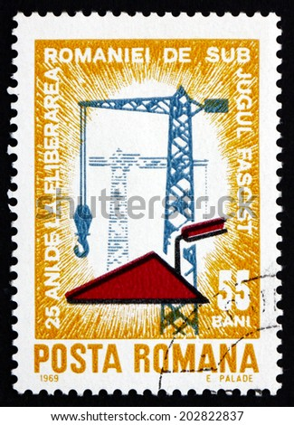ROMANIA - CIRCA 1969: a stamp printed in Romania shows Construction Work, 25th Anniversary of Romanias Liberation from Fascist Rule, circa 1969