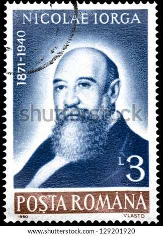 "ROMANIA - CIRCA 1990: A stamp printed in Romania, shows portrait of Nicolae Iorga, 1871 � 1940, (historian), with the same inscription, from the series ""Anniversaries"", circa 1990"