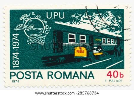 ROMANIA - CIRCA 1974: A stamp printed in Romania shows Postal rail wagons, circa 1974 - stock photo