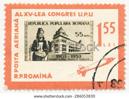 ROMANIA - CIRCA 1963: A stamp printed in Romania shows rocket and Stamp 1953 with Postal Administration Building and Telegraph employees, circa 1963 - stock photo
