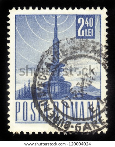ROMANIA - CIRCA 1967: A stamp printed in the Romania, shows a television tower and the the symbol of broadcast signal, circa 1967