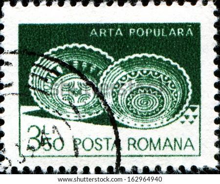 ROMANIA - CIRCA 1982: A stamp printed in the Romania  shows Ceramic plates from Leheceni, circa 1982  - stock photo