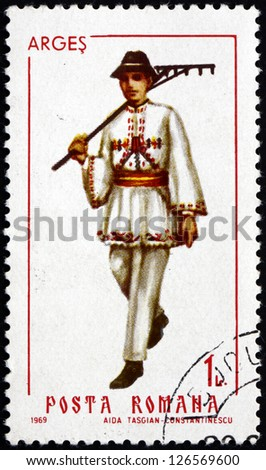 ROMANIA - CIRCA 1969: a stamp printed in the Romania shows Man from Arges, Traditional Regional Costume, circa 1969 - stock photo