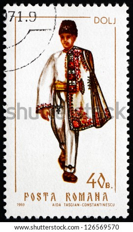 ROMANIA - CIRCA 1969: a stamp printed in the Romania shows Man from Dolj, Traditional Regional Costume, circa 1969 - stock photo