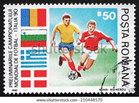 ROMANIA - CIRCA 1990: a stamp printed in the Romania shows Soccer Players in Action, World Cup Soccer Preliminaries, Italy, circa 1990 - stock photo