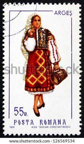 ROMANIA - CIRCA 1969: a stamp printed in the Romania shows Woman from Arges, Traditional Regional Costume, circa 1969 - stock photo