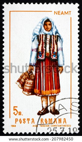 ROMANIA - CIRCA 1968: a stamp printed in the Romania shows Woman from Neamt, Traditional Regional Costume, circa 1968 - stock photo