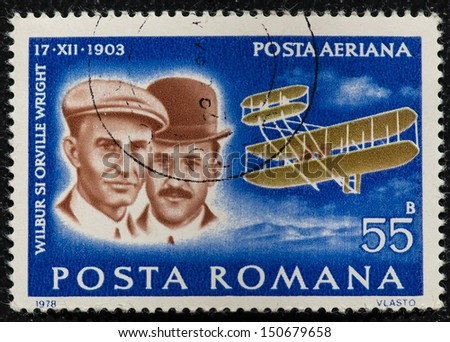 ROMANIA - CIRCA 1978: Mail stamp printed in Romania showing the Wright Brothers, aviators Orville and Wilbur Wright, who first powered aircraft flight, circa 1978  - stock photo