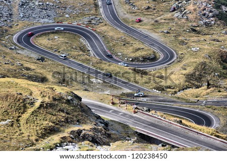 Romania - Fagaras Mountains in Transilvania. Famous Transfagarasan mountain winding road. - stock photo