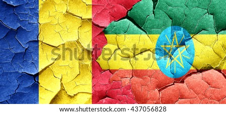 Romania flag with Ethiopia flag on a grunge cracked wall - stock photo