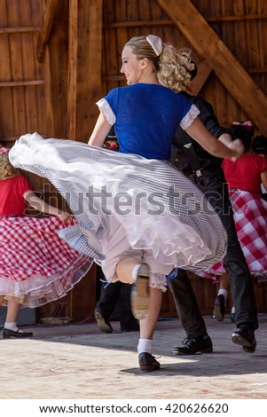 ROMANIA, TIMISOARA-JULY 12, 2015:Unidentified youths from California in traditional dress, presented an specific dance at a international folk dance festival,during ,,International Festival of hearts""