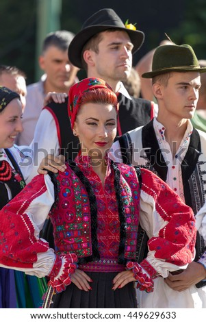 "ROMANIA, TIMISOARA - JULY 7, 2016:Woman and man from Romania in traditional costume, present at the international folk festival, ""International Festival of hearts"" organized by the City Hall Timisoara"