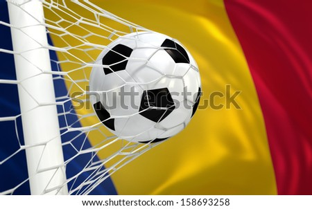 Romania waving flag and soccer ball in goal net - stock photo