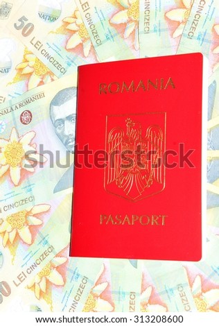 Romanian passport and currency - stock photo