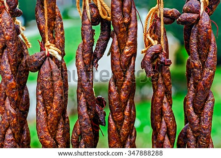 Romanian sausages (carnati), smoked and dried, exposed for sale. Shall specify for the month of December in Maramures area, Romania. - stock photo