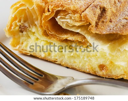 Romanian traditional cheese pie on a white plate.