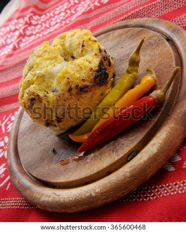 """Romanian traditional smoked and grilled polenta with cheese, named """"bulz"""" - stock photo"""