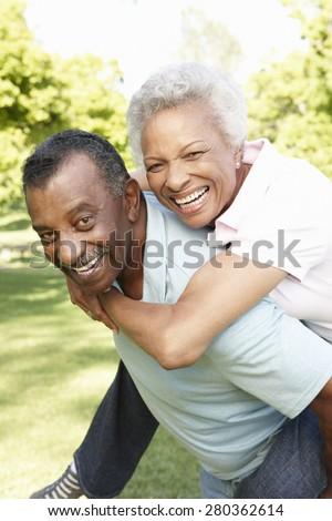 Romantic African American Couple Having Fun In Park - stock photo