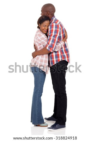 romantic african couple hugging with eyes closed on white background