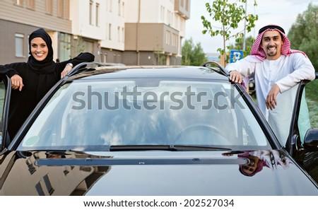 Romantic Arabian Couple Posing Next To Car - stock photo