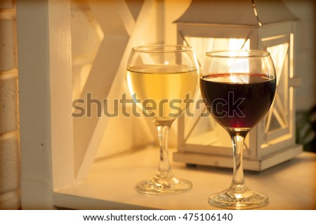 Romantic background with glasses of wine. Retro lamp. Intimate lighting. selective focus