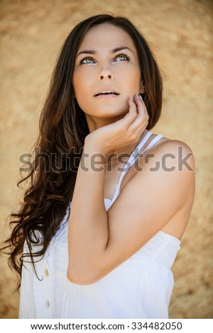 romantic beautiful long dark hair woman looking up - stock photo